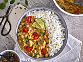 Spicy chickpea curry with cherry tomatoes and rice