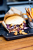 Burger with red cabbage and french fries