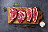Variety of fresh Black Angus Prime raw beef steaks