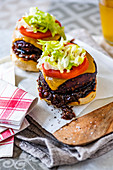 Giant black mushrooms burgers with whiskey onion relish