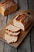 Wholemeal spelt bread sliced on a wooden board