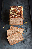 Whole grain bread with linseed and oatmeal on a baking sheet
