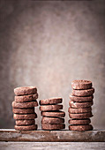 Stacked chocolate cookies on a stone plate