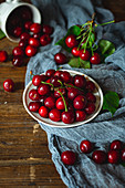 Sweet organic cherries on wooden table