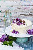 Ricotta frosted cake with lilacs