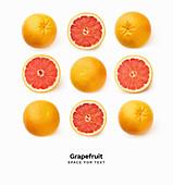 Reihen von frischen Grapefruits, ganz und halbiert