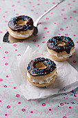Vegan dark-glazed donuts filled with vanilla soy cream