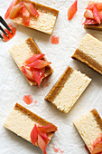 Pieces of cheesecake with rhubarb compote