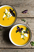 Pumpkin soup with cream cheese and fresh herbs