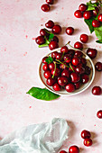 Organic cherries on pink background