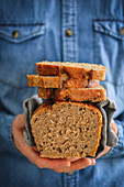 Homemade wheat bread in a mans hands