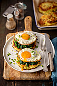 Potato cakes with spinach and fried egg