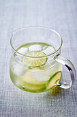 Water with lime slices and ice cubes
