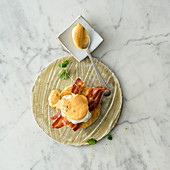 Eggs Benedict with bacon and Maltese sauce