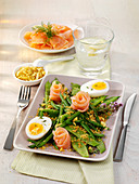 A platter of beans with smoked salmon and boiled eggs