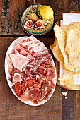 Cold meat platter, figs, lemon and Sardinian flatbread