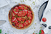 Puff pastry tart with strawberries and pistachios