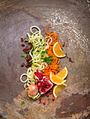 Coodles and zoodles with pomegranate, coriander, oranges, raisins and onions