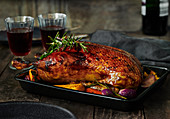 Crispy roast duck in a black baking dish