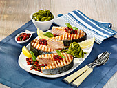 Salmon steaks with pepper and olive relish