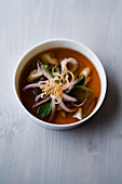 Roast squid broth with allspice and mint