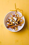 Roasted vegetable salad with goat's cheese and coriander churros