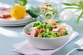 Bean salad with raw ham, onions and lemon zest