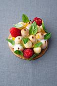 Lemon and basil tart with raspberries