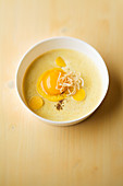 Corn and shallot cream with mango polenta and caraway seeds