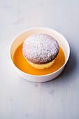 Quark and lime soufflé with mango and saffron jus