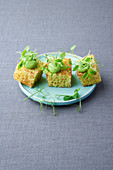 Parsley and pepper brioche with pea hummus