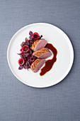 Duck breast with juniper glaze, shiso barley and hibiscus onions