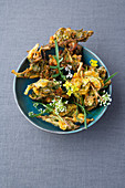 Zucchini flower and onion pakoras