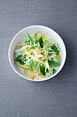 White cabbage and apple salad with cumin and Thai basil