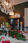 Festively set table in classic dining room decorated for Christmas