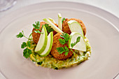 Breaded snails on leek and apple slices