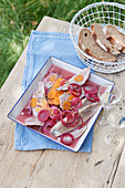 Swedish pickled herring with carrots and onions