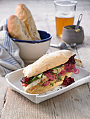 Hot dogs with zander fish sausage, mustard and beetroot crisps