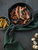 Crisp duck breast in a spicy balsamic mushroom reduction