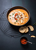 Vegan bell pepper and potato soup with ajvar and garlic bread chips