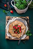Savoury vegan spelt galette with strawberries and basil pesto
