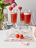 Rose mimosas with strawberries for Easter