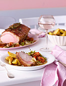 Roast pork Toscana with roasted potatoes and bean salad