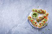 Savoury eclairs with avocado, salmon and cress