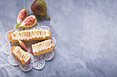 Eclairs with figs and cream