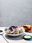 Fried pipis with garlic, chilli and celery