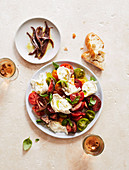 Insalata of tomatoes, mozzarella and basil with anchovies