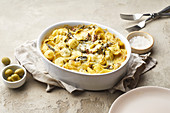 Pasta bake with sausage, sage, cheddar and cream
