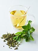 Mint tea, fresh mint and dried tea leaves
