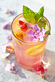 Edible flowers-Watermelon lemonade with flower ice cubes, mint and edible flower garnish